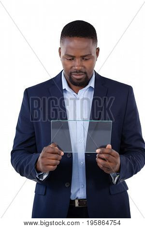 Businessman using a glass digital tablet against white background