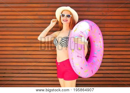 Fashion, Summer Holidays Concept - Pretty Smiling Woman With Inflatable Ring On Wooden Background