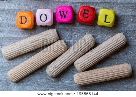 Letter cubes and dowels on gray wood visualization