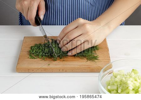 Step By Step Recipe For Tarator. Hands Cut A Dill On Board In The Kitchen.