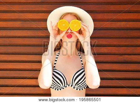 Summer Portrait Happy Woman Holds In Hands Oranges And Hides His Eyes On Wooden Background
