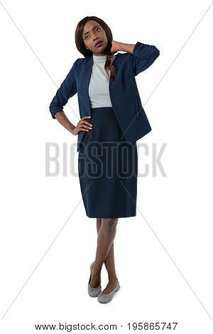 Businesswoman suffering from neck pain standing against white background