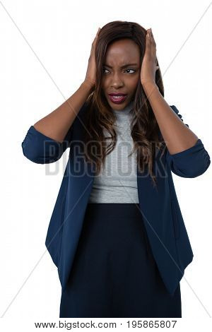 Businesswoman with head in hand looking away while standing against white background