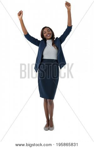 Portrait of happy businesswoman with arms raised standing against white background