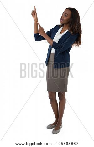Full length of businesswoman gesturing during presentation against white background