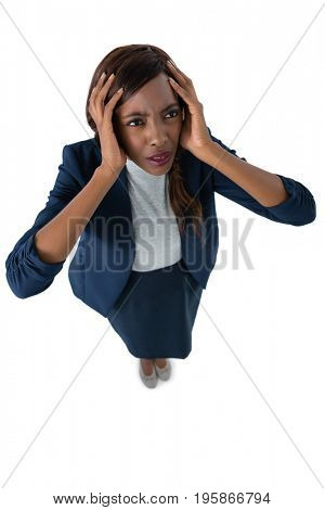 High angle view of businesswoman with hand in head standing against white background