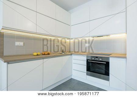 Modern kitchen interior design in white finishing