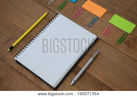 Various school supplies arranged on wooden table