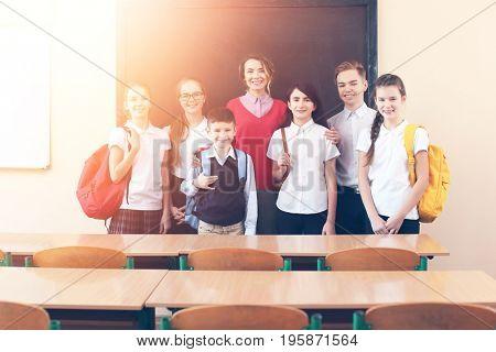 Children with teacher in classroom at school