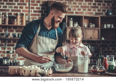 Dad And Daughter Cooking