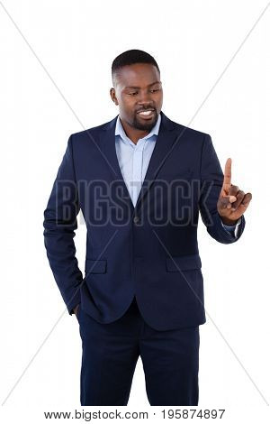 Classy businessman pointing his finger while talking against white background