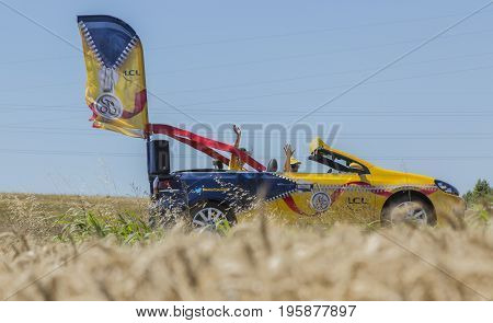 Saint-Quentin-Fallavier France - July 16 2016: LCL convertible during the passing of Publicity Caravan in a wheat plain in the stage 14 of Tour de France 2016. LCL was the largest bank in France and sponsored continuosly the TDF during more then 30 years.