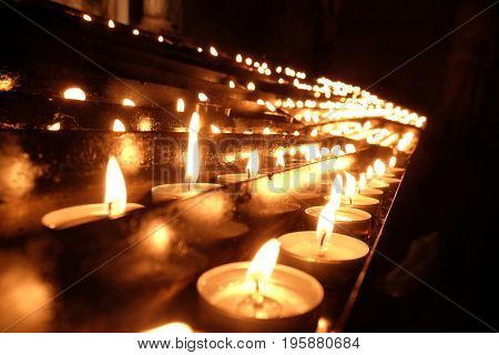 ZAGREB, CROATIA - DECEMBER 18: Lit candles on the altar of Our Lady in the Cathedral of the Assumption of Mary in Zagreb, Croatia on December 18, 2015.