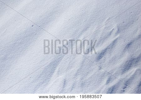 White snow in the mountains as a background .