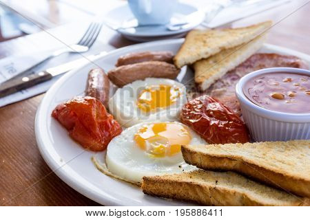 classical english breakfast with egg and fries