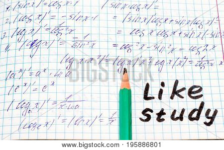 A simple pencil lies on the school note in mathematics near the inscription in English like study