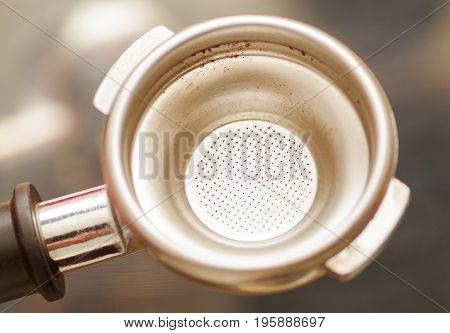 Close up of coffee strainer, in a blurred background.