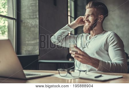 A Man While Working In An Office