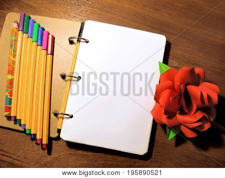 Mock up note book pen pencil paper rose peony flower photo