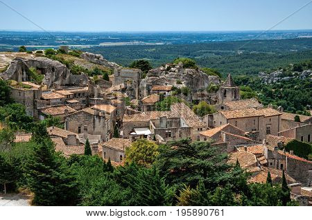 View of the roofs and houses of the village of Baux-de-Provence, with the hills of Provence just below. Bouches-du-Rhône department, Provence-Alpes-Côte d'Azur region, southeastern France