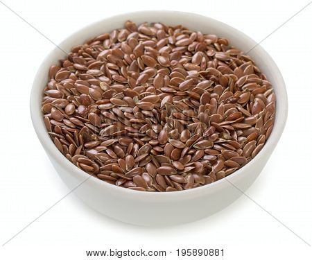 Little Bowl Of Dried Flax Seeds Isolated On White Background, Close Up.