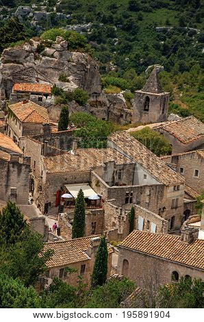 View of the roofs and houses of the village of Baux-de-Provence, with the hills of Provence. Bouches-du-Rhône department, Provence-Alpes-Côte d'Azur region, southeastern France