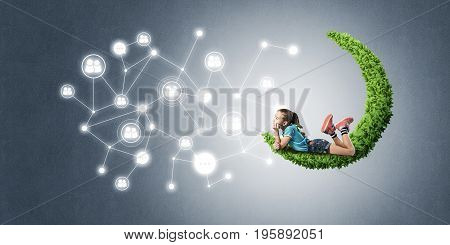 Cute kid girl sitting on green moon and connection concept