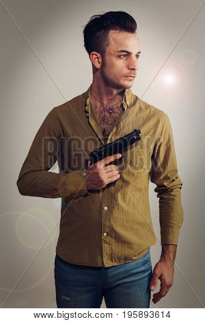 Boy with gun on white background