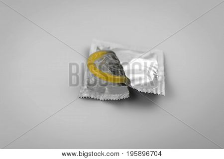 Condom close-up isolated. Contraceptive protection from pregnancy AIDS.