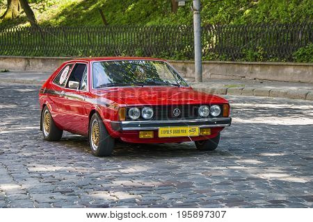 Lviv Ukraine - June 4 2017: Old retro car Volkswagen Scirocco with its owner and au unknown passenger taking participation in race Leopolis grand prix 2017 Ukraine.
