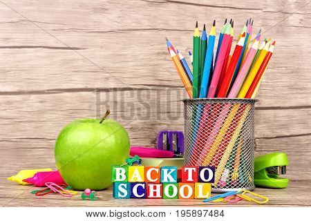 Colorful Back To School Wooden Blocks With School Supplies Against A Rustic Wood Background
