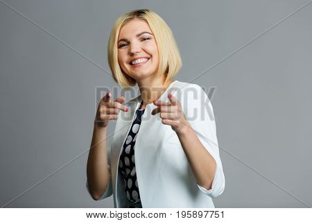 Woman showing fingers in camera