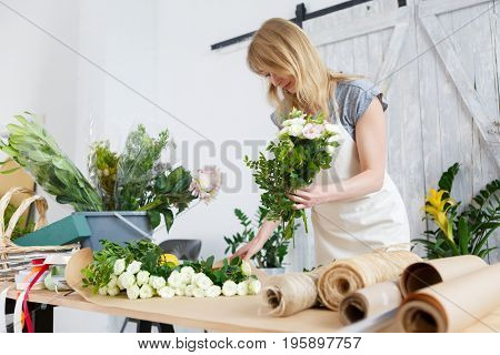 Photo of blonde making bouquet