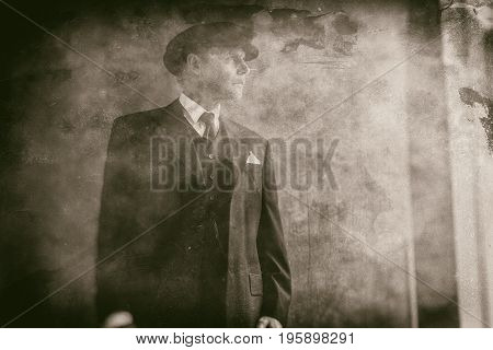 Retro 1920S English Gangster Wearing Flat Cap And Suit. Looking Out Window.