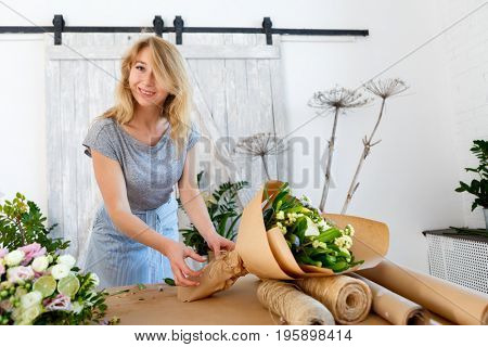 Long haired florist with bouquet