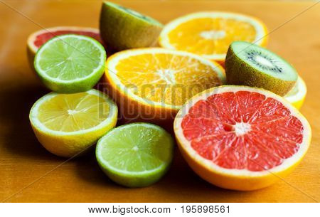 Citrus fruits. Fresh fruits. Mixed fruits background. Healthy eating, dieting. Background of healthy fresh fruits. Fruit salad - diet, healthy breakfast. pomegranate, lemon