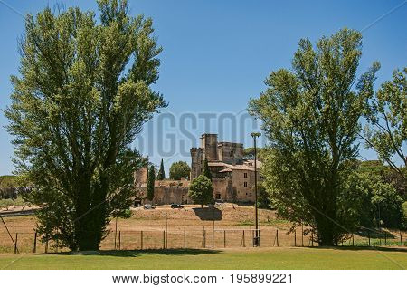 Panoramic view of Lourmarin Castle on top of a hill, near the village of the same name. Located in the Vaucluse department, Provence-Alpes-Côte d'Azur region, southeastern France