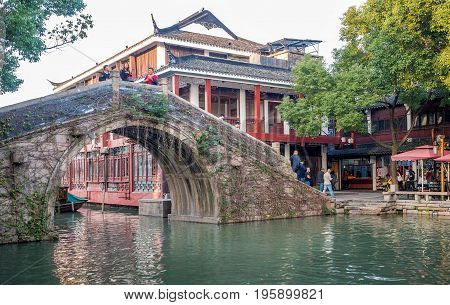 Suzhou, China - Nov 5, 2016: Ancient arch bridge and waterway at the historic Zhouzhuang Water Town.