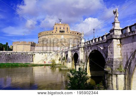 Rome Italy,November 5th 2013.An ancient bridge with Bernini influenced sculptures spans the Tiber river to Castel Sant'Angelo .Built as a tomb for emperor Hadrian it is now a museum for all who enter can enjoy.Come explore the Eternal city of Rome.