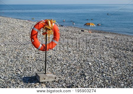 Lifebuoy hangs on the beach for the safety of people on swimming on sea