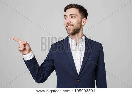 Business Concept - Portrait Handsome Business man confident smile pointing with finger. White Background.