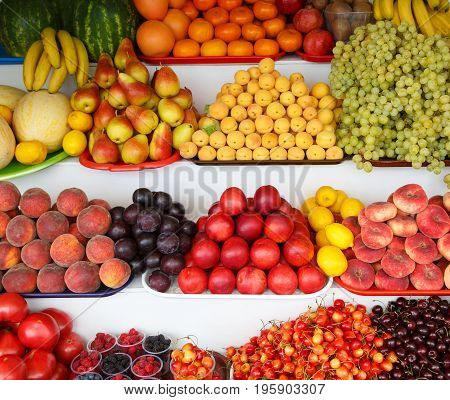 Many fresh ripe and useful fruits lie on the counter