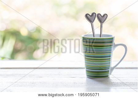 Cup On Wooden Table With Spoon Shape Heart