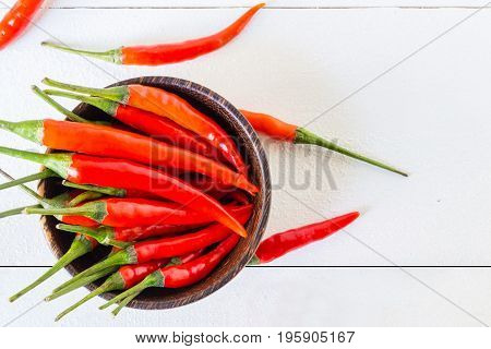 Fresh Red Chilli With Wooden Bowl On Table