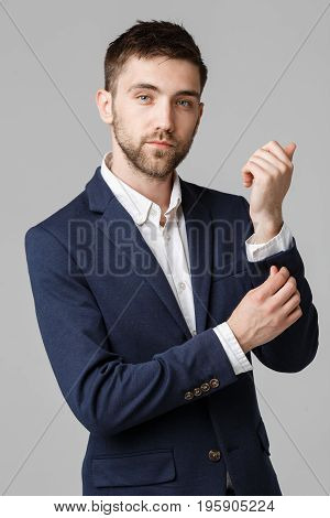 Business Concept - Young successful businessman posing over dark background. Isolated White Background. Copy space.