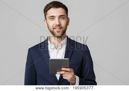 Business Concept - Portrait Handsome Business man playing digital tablet with smiling confident face. White Background. Copy Space.