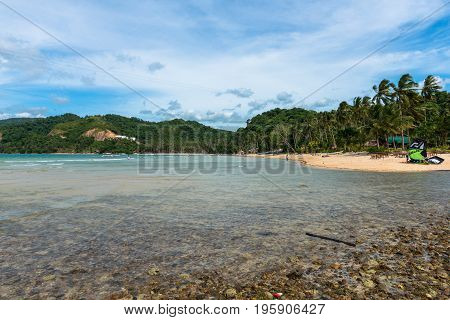 EL NIDO PALAWAN PHILIPPINES - JANUARY 18 2017: Horizontal picture of Las Cabanas Beach with clean water and many coconut trees in El Nido.