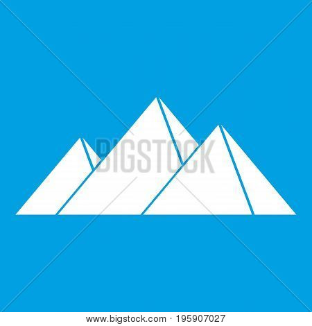 Pyramids in Giza icon white isolated on blue background vector illustration