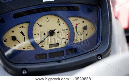 Modern tractor dashboard: speedometer, fuel level, engine temperature.