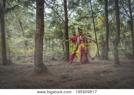 Kampung Mek Mas Kota Bahru Kelantan / Malaysia - July 15 2017 : A shot of two person in traditional clothing performing a dance called